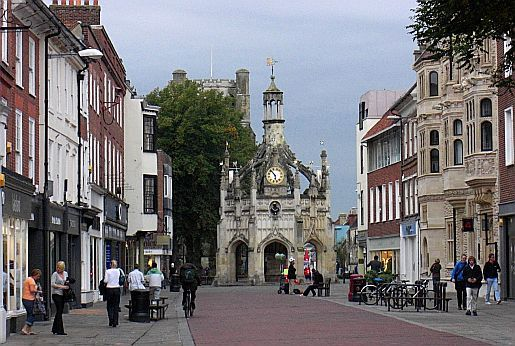 Looking along East Street, Chichester towards the Market Cross with the Cathedral Tower behind it