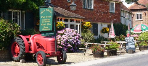 picture of the famous old tractor outside the Half Moon pub in Northchapel